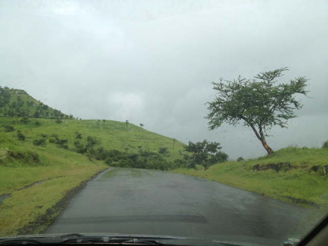 Raining while driving in the beautiful scenic road
