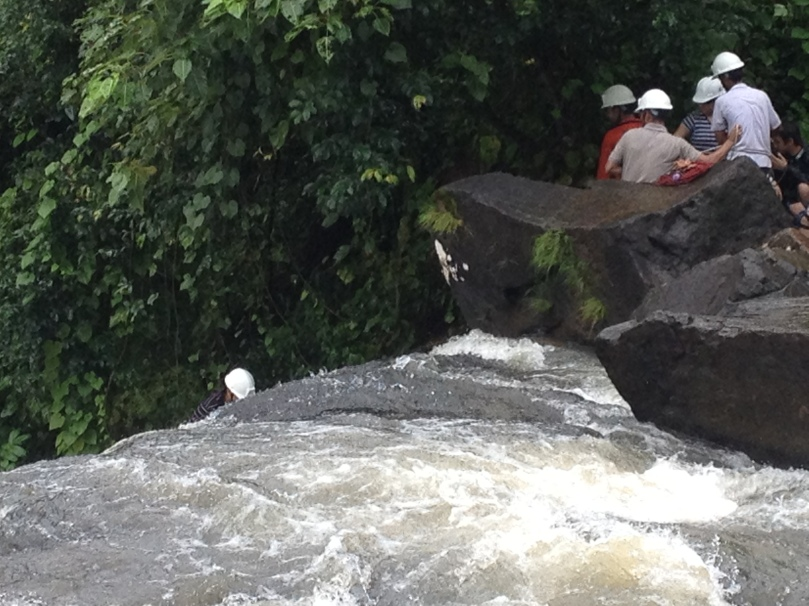 Waterfall rapelling by another group