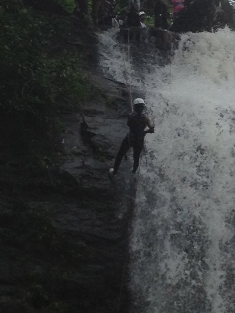Waterfall rappelling by another group